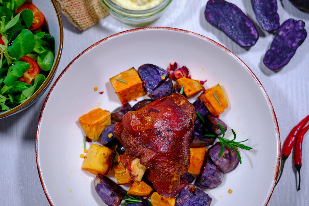 Roasted mini pork shank with colorful potatoes